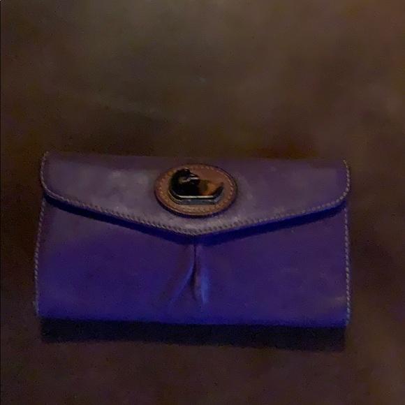 Purple leather Dooney Bourke checkbook organizer